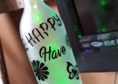 lighted etched wine bottle